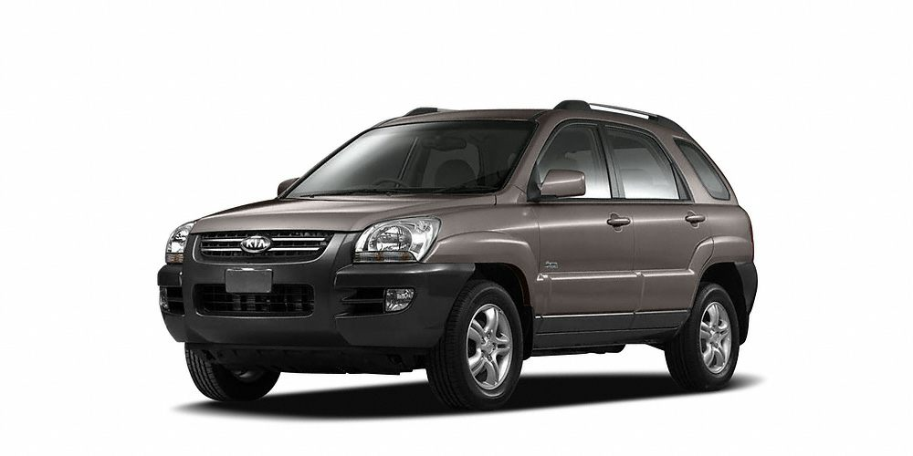 2005 Kia Sportage  Miles 94009Color Brown Stock 17230R VIN KNDJE723657110457